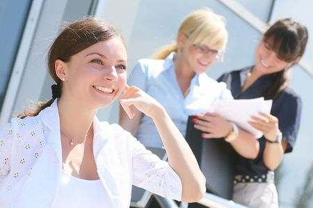 Portrait of an elegant business woman gesturing a phone call Stock Photo - 5677810