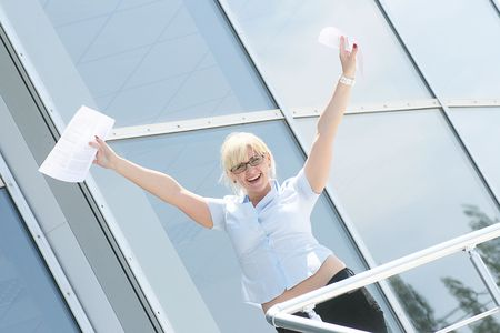 Portrait of an attractive businesswoman with her arms raised in celebration. photo