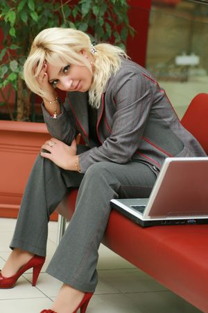 Young woman thinking, sitting on workplace. Stock Photo
