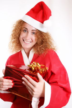 Portrait of a happy lady Santa with a Christmas gift