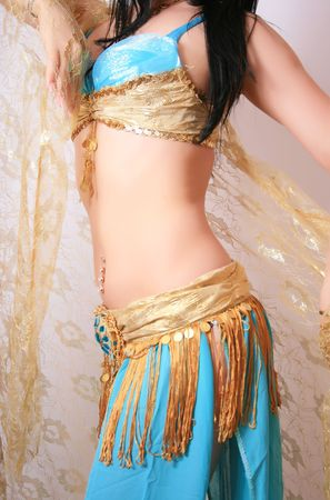 Beautiful belly dancer in blue outfit, isolated