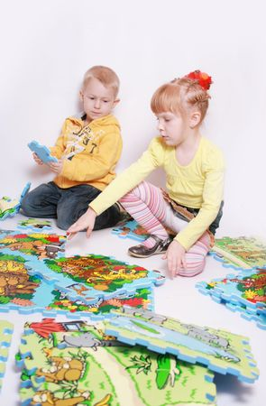 Happy children playing on the floor photo