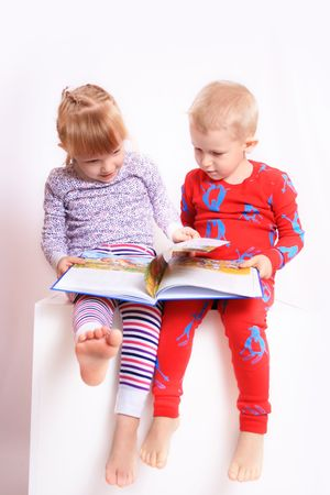 kindred: Happy children reading a book