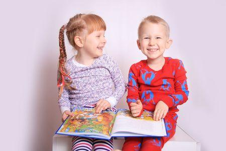 Happy children reading a book photo