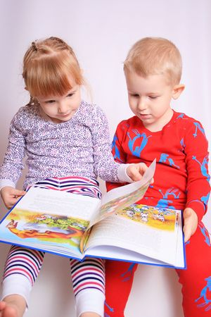 brethren: Happy children reading a book