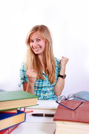 Studying happy young woman reading her book for school. Stock Photo