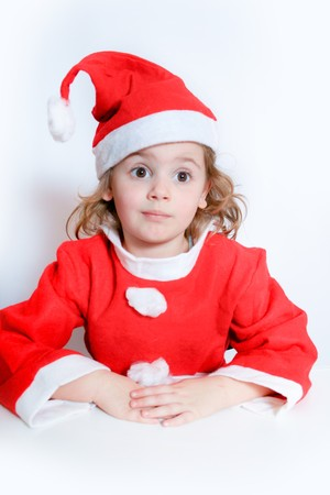 Portrait of little girl in Santas hat photo