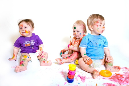 Group of babies painting on white background