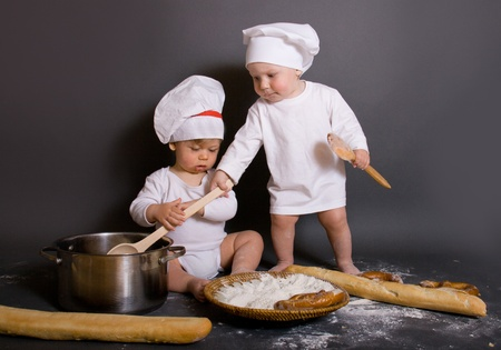 boys  with kitchen accessories and  cook hat