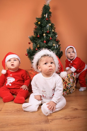 Portrait of lovely babies with Christmas decoration photo
