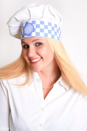 A portrait of a beautiful female chef, isolated on a white studio background  photo