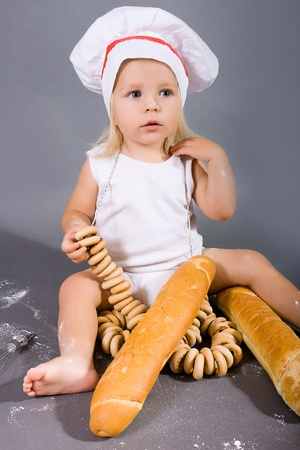 Happy little girl with chef hat photo