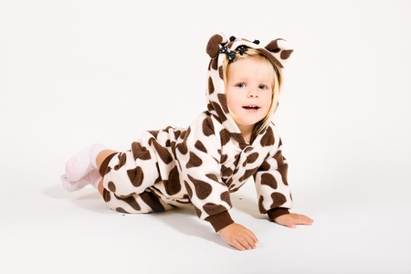 Little girl in costume of giraffe photo