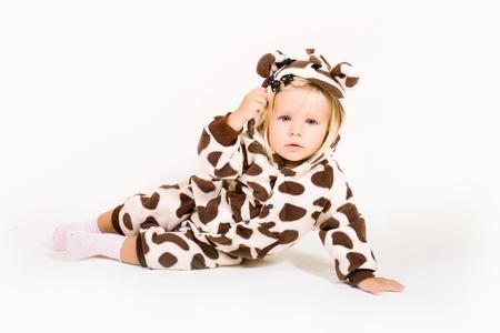 Little girl in costume of giraffe photo