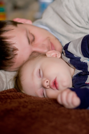 Newborn baby sleeping with father Stock Photo - 14159898