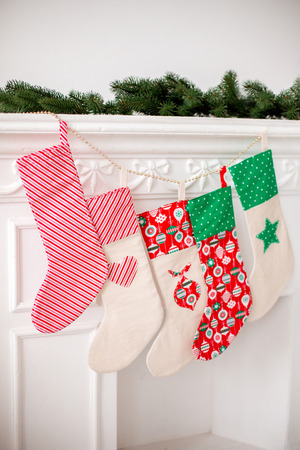 Christmas socks with gifts on the fireplace