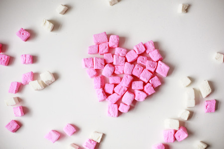 pink  marshmallows in the shape of a heart.