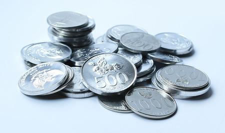 rupiah: Rupiah coins on white background Stock Photo
