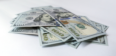 batch of dollars: US dollar on white background Stock Photo