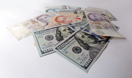 batch of dollars: Singapore and US Dollar isolated on white background