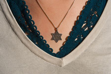 hebraism: Necklace with the Star of David on a girls chest