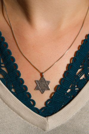 Necklace with the Star of David on a girl's chest Stock Photo - 5761347