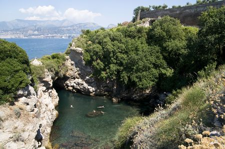 Above view of a bay with crystal clear waters in Amalfi, Italy photo