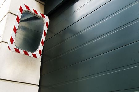 Entrance of a garage with a mirror, in Berlin photo