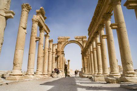Colonnade in roman ruins of Palmyra, Syria photo