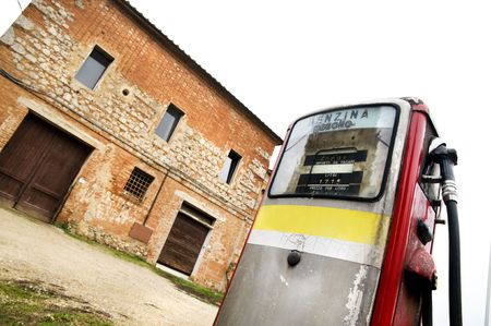 Very old gas pump in Tuscany, in the area between Siena and Asciano (Italy) photo