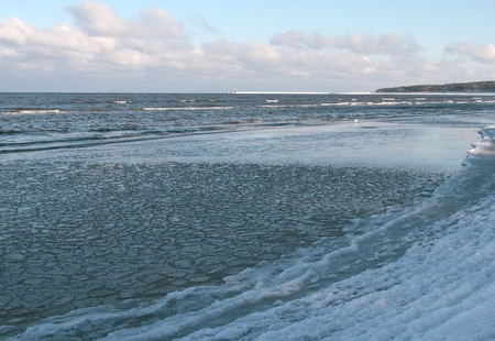 discontinuous: The first ice on the Greifswalder Bodden on the beach of Lubmin. Stock Photo