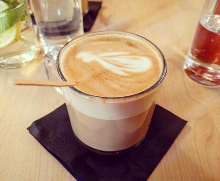 Fancy looking Latte with flower in restaurant Reklamní fotografie