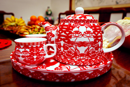Traditional Chinese wedding tea pot and set in red Stock Photo