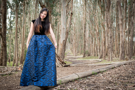 Girl posing in the forest for engagment photo