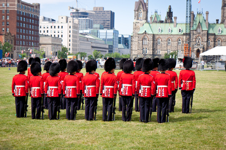 guard house: Ottawa, Canada - July 3, 2011: changing of the guard in front of the Parliament of Canada on Parliament Hill in Ottawa, Canada
