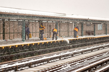 MTA workers shoveling snow off the D train 71st Street platform on February 9th, 2017.