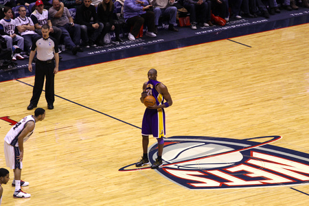 Kobe Bryant and the LA Lakers playing against the old New Jersey Nets at Izod Center in New Jersey on Dec 19th, 2009.