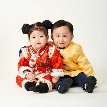 Chinese Baby Boy And Girl In Traditional Chinese New Year Outfit