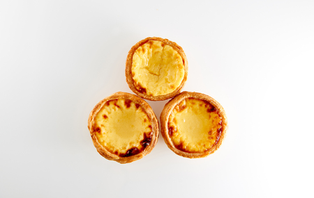 macau: 3 tasty Portugese Custard Tarts with reflection isolated on white background