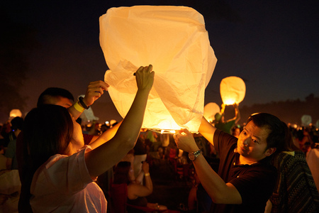 Group of people trying to lid up the lantern to set it fly high on Lantern Festival in PA on June 10th 2017.