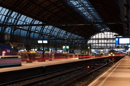 Amsterdam, Netherlands - November 2017: Amsterdam Centraal Station, one of the biggest and busiest train station in the world. On platform 15b for high speed train to Paris, France.