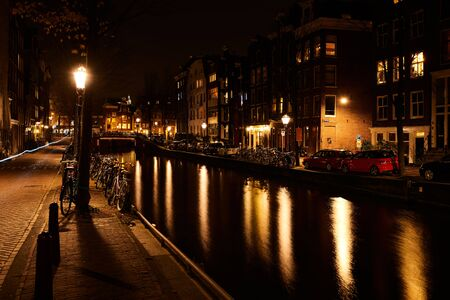 Amsterdam, Netherlands - November 2017: Illuminated canal bridge at night on the canal between Herengracht and Brouwersgracht. Amsterdan canal is one of the world famous sightseeing spot. Editorial