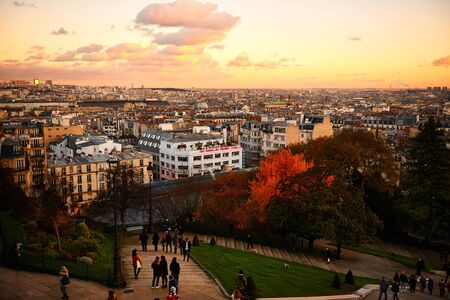 Paris, France - November 2017: Paris city view from the high ground of the famous Sacre Coeur Cathedral during the beautiful sunset.