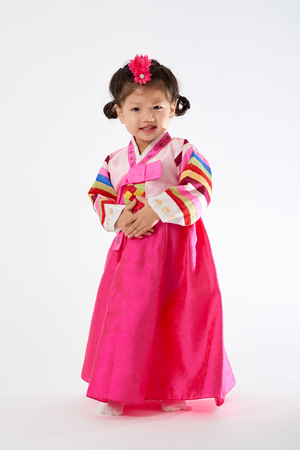 Smile Korean little girl wearing a Traditional Hanbok dress in white background