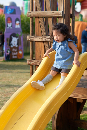 Free play in the playground for baby and toddler is important activity for child development. Stock Photo