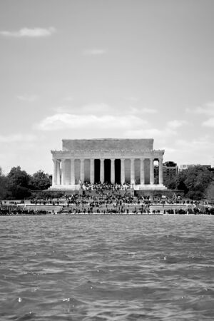 Washington DC, USA - April 2018: Lincoln Memorial close up in black and white viewed from across the mirror lake. Editorial