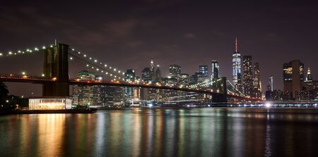 The Brooklyn Bridge, connects the boroughs of Manhattan and Brooklyn by spanning the East River. Lower Manhattan, in the background, is the southernmost part of the island of Manhattan.