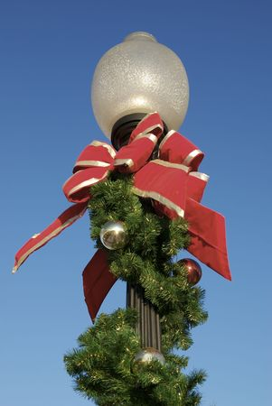 A lamp post decorated for the holidays. Stock Photo