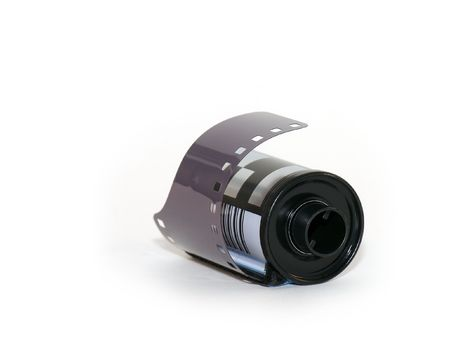 A roll of black and white film shot isolated against a white background. Stock Photo