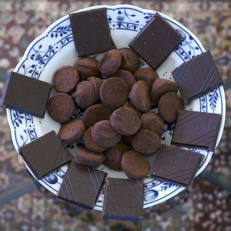 A bowl of mixed chocolate candies shot from above. Stock Photo